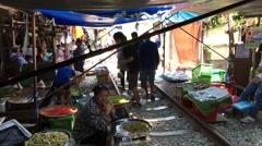 People at the Maeklong Railway Market (Taled Rom Hoop) Stock Footage