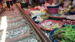 Food at the Maeklong Railway Market (Taled Rom Hoop) Stock Footage