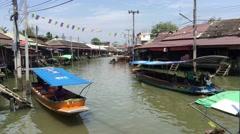 Long tail boats at Amphawa Floating Market Stock Footage
