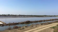 View from the train passing by salt farms on the way from Samut Songkhram Stock Footage