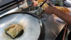 Making banana pancake on the street Stock Footage
