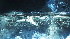 Soda bubbles floating up in liquid and ice. - stock footage