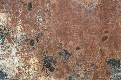 Rusty splodgy iron brown background with spots Stock Photos