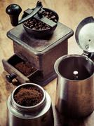Moka express coffee maker and grinder - stock photo