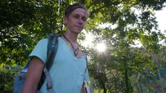 Hipster Traveler with Backpack Showing Peace Sign in Forest. Stock Footage