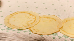Female hand turns out the pan and pancake falls Stock Footage