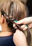 weave braids in the beauty salon - stock photo