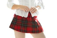 sexy woman in short skirt unbuttoning white shirt - stock photo