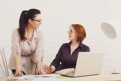Conflict. Women discuss project in office - stock photo