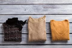 Sweaters of different color. Stock Photos