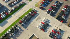New cars and trucks on lot of large automobile dealership Stock Footage