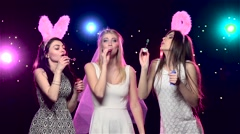 Girls at bachelorette party blowing soap bubbles. Slow motion Stock Footage