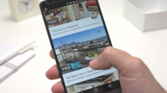 4K Looking to Rent a Room on Airbnb App on Smartphone Stock Footage
