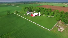 Cloud shadows drift across rural landscape of farms and fields Stock Footage