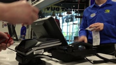 Man returning JBL bluetooth speaker and signature on payment terminal inside Stock Footage
