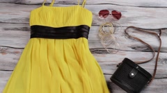Yellow dress and black purse. Stock Footage