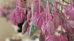Decoration pink and green hearts are hanging from tree. Close up Stock Footage