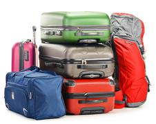 Luggage consisting of large suitcases rucksack and travel bag isolated on whi - stock photo