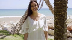 Gorgeous woman in white near palm trees Stock Footage