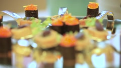 Pancakes and rolls are on the holiday table. Dynamic change of focus. Close up Stock Footage