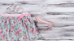 Floral skirt and salmon heels. Stock Footage