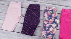 Folded pants of different color. Stock Footage