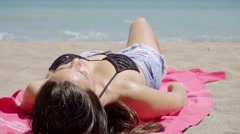 Young woman soaking up the summer sun Stock Footage