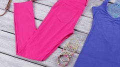 Blue top and pink pants. - stock footage