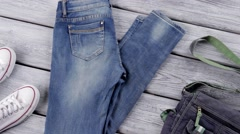 Blue jeans and denim purse. - stock footage