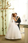 newly married couple kissing at registry office - stock photo