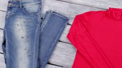 Blue jeans and red top. Stock Footage