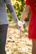 Happy couple holding hands at park Stock Photos