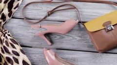Handbag and salmon heel shoes. Stock Footage