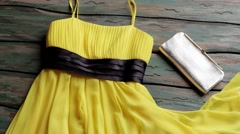 Yellow dress and silver purse. Stock Footage