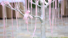 Decoration ribbon and beads are hanging from tree. Close up Stock Footage