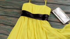 Yellow summer dress and purse. Stock Footage