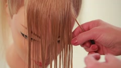 Girl makes a braid. Wizard makes the hair of the mannequin. White. Close up Stock Footage