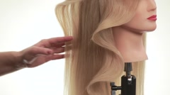 Wave of hair on the dummy. Hair on his head turned in profile. White. Close up - stock footage