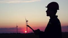 Civil engineer wind power. Sunset. Stock Footage