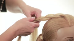 French braid. Weave braids for long hair. Close up - stock footage