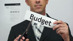 Businessman Cuts Budget Concept Stock Footage