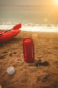 Red lifeguard equipment on beach at sunny day Stock Photos