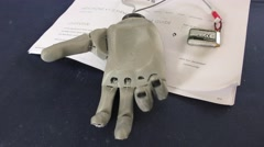 A 3D printed robotic bionic hand is displayed to the help of amputated persons Stock Footage