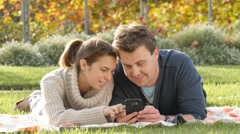 Young woman and man looking at social media on mobile smart phone device Arkistovideo