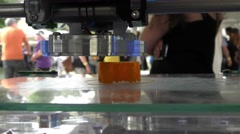 A 3D printer creates a prototype model made of plastic Stock Footage