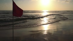 Red flag on Kuta beach at sunset time Stock Footage