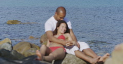4K Portrait of happy smiling couple relaxing together at the beach.  Stock Footage