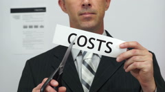 Businessman Cuts Costs Concept - stock footage