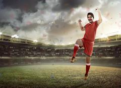 Winning football player Kuvituskuvat