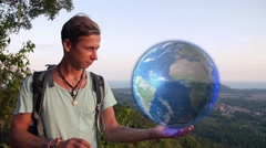 Traveler Holds Hologram Earth in Hand. Interactive Globe Map. - stock footage